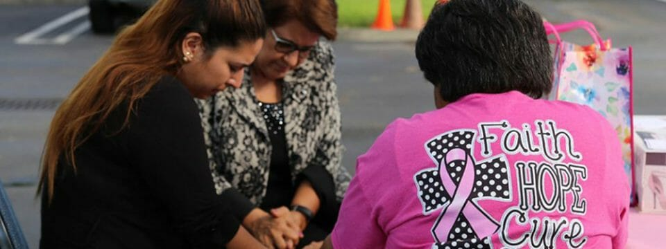 drivers-and-onlookers-are-prayed-for-at-breast-cancer-awareness-outreach
