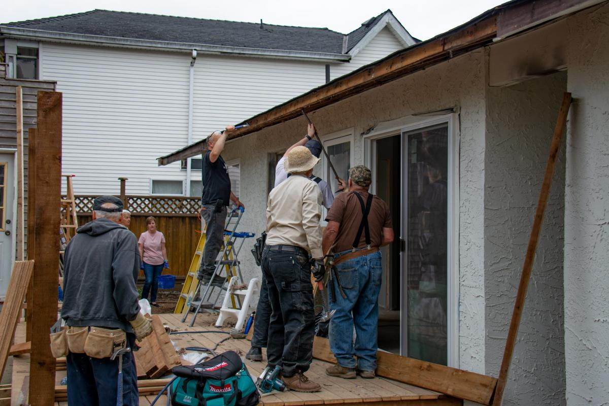 The Extreme Home Repair team works on its eighteenth project, the home of single mom Ledell Kendall in Aldergrove, British Columbia, Canada. [Photo: Church in the Valley Acts of Kindness]